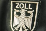 Zollwappen an Uniform