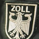 Zollwappen an Uniform